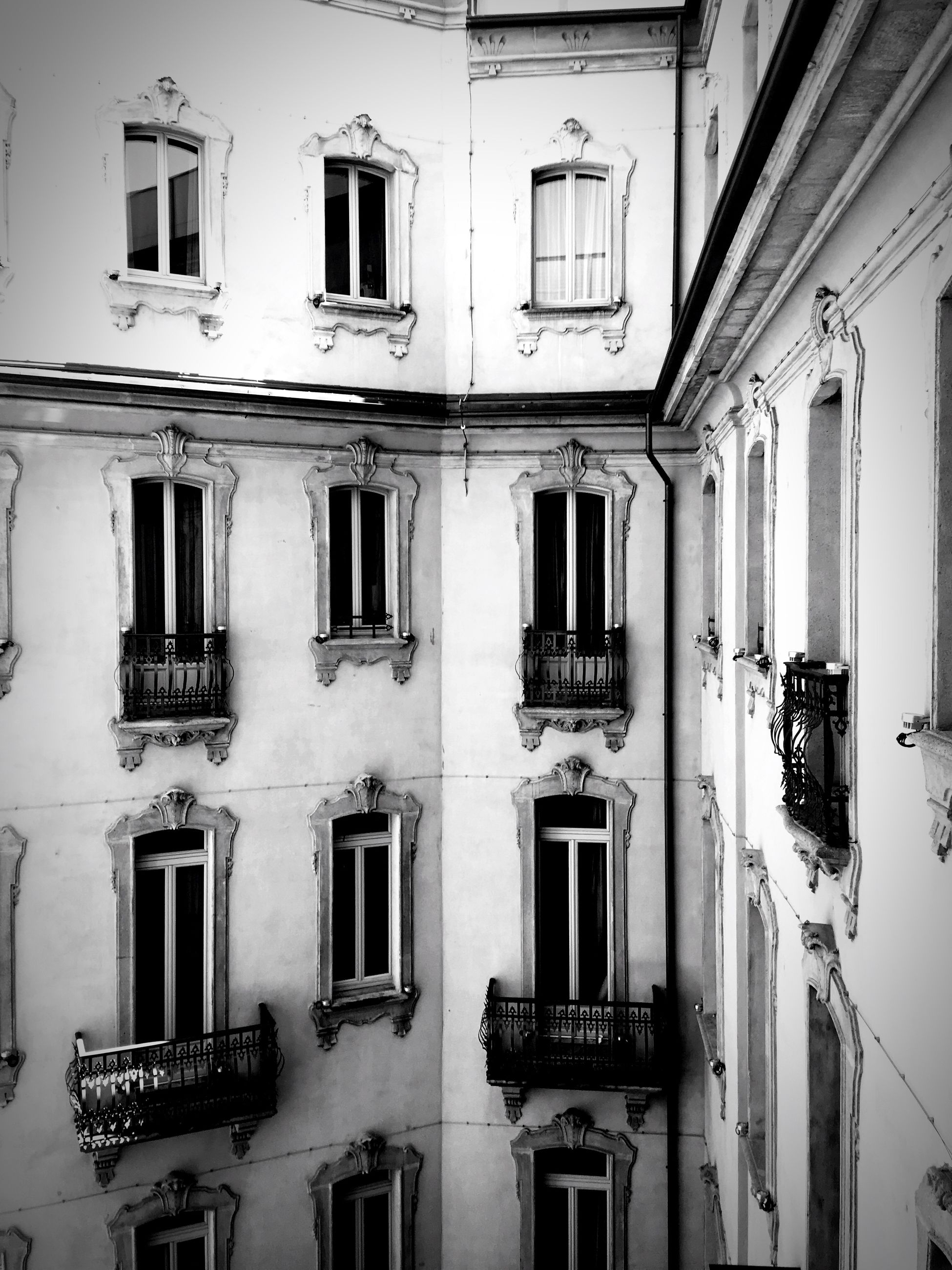 architecture, building exterior, built structure, window, residential building, building, residential structure, low angle view, balcony, full frame, house, in a row, day, facade, no people, city, outdoors, side by side, repetition, door