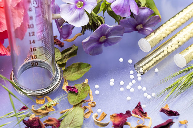 small glass tubes with homeopathy globules, syringe and flowers Bottle Disease Drug Flowers Glass Globules Healing Health Herbal Homeopathy Medical Medicine Nature Pill Still Life Stillife Therapy