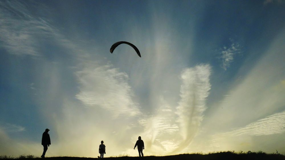 Flying Silhouette People Sky Outdoors Nature Paragliding Extreme Sports Parachute Adult One Person Bird Beauty In Nature Day Adults Only Mammal