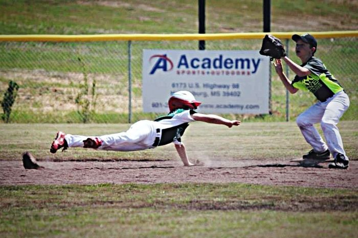 My son diving back to 2nd base.. & he was SAFE!!