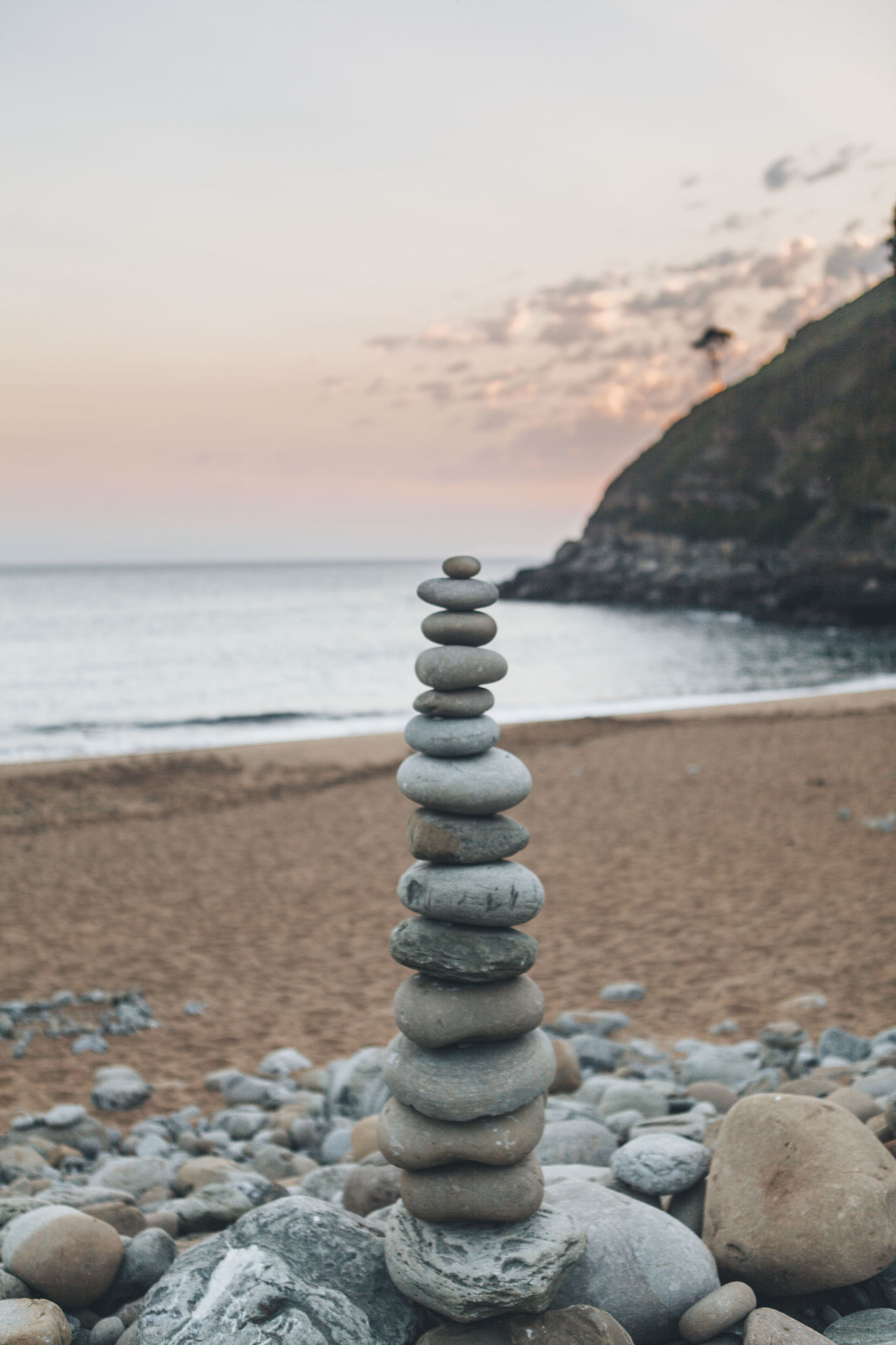 Sunrise_Collection balance beach close-up day horizon over water idyllic Nature no people outdoors pebble Pebble Beach rock - object scenics sea sky stone - object sunrise sunrise and clouds sunset tranquil scene Tranquility water