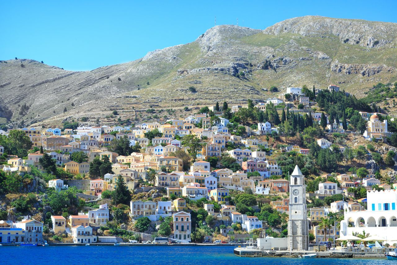 Panoramix view at the beautiful town of Symi, at Symi island, in Greece Architecture Church Clock Tower Colorful Dodecanese Family Vacation Greece Greek Islands Harbor Hill Nature Nature_collection Orthodox Perfect Summer Summer Holidays Sunny Symi  Symi Town Symi ısland Travel Travel Destinations Yacht Yacht Destination