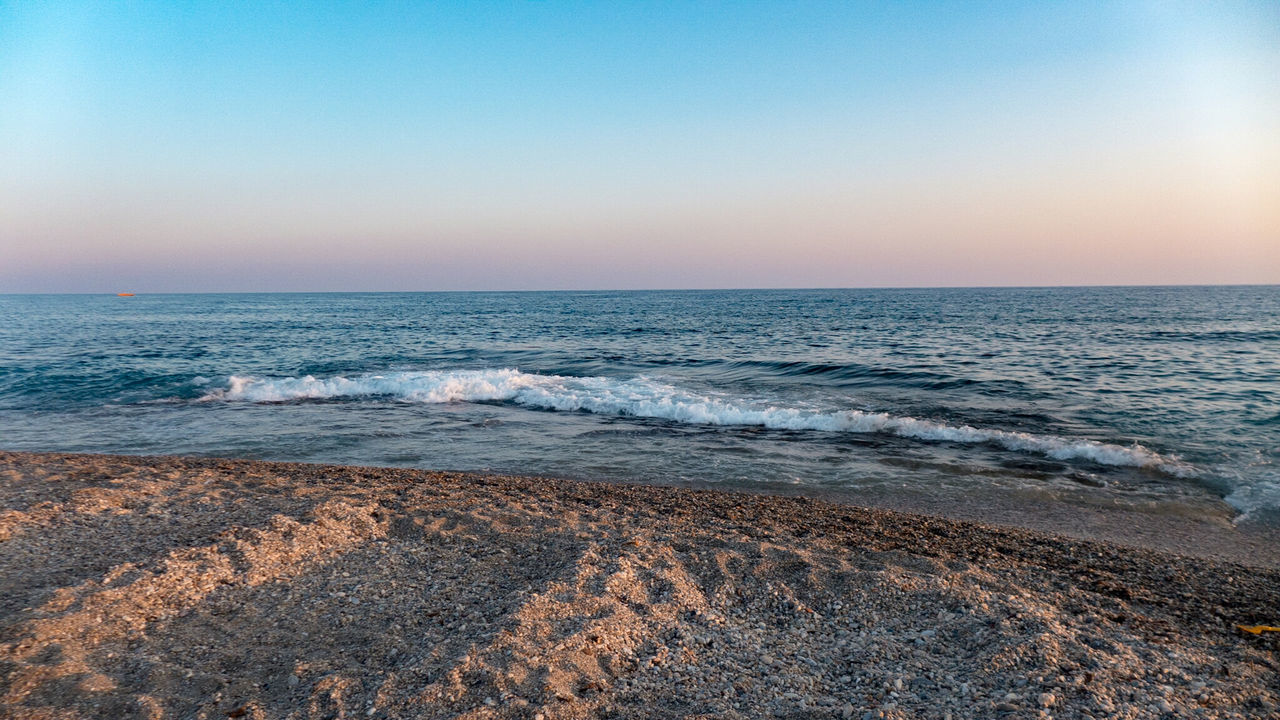 EyeEm Selects Beach Sea Sand Horizon Over Water Nature Outdoors Pebble Water Tranquility Sunset Wave Sky Beauty In Nature Scenics Sunlight No People Clear Sky Vacations Day Blue Beauty Travel Destinations Photography Travel