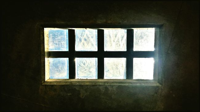 I was inside a concrete bunker and this was the only source of light - some glass bricks cleverly built into the ceiling Skylight Glass Bricks Single Light Source Light And Darkness  Sunlight Obscured Showcase: January
