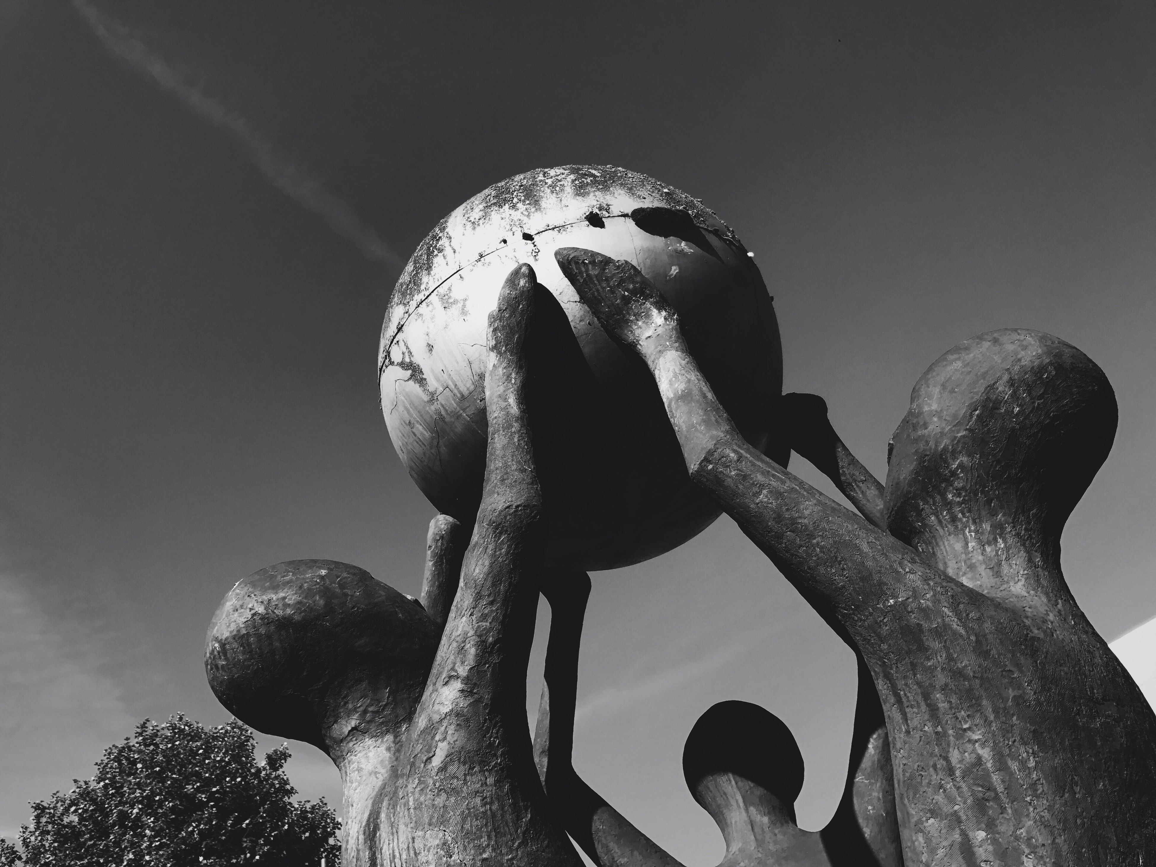 low angle view, sculpture, statue, no people, outdoors, sky, day, close-up