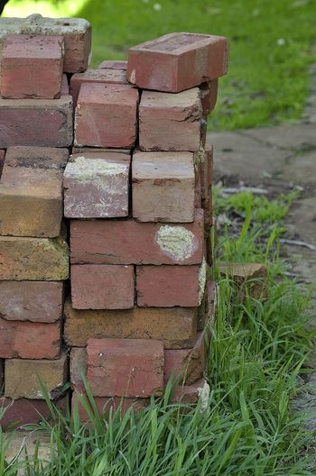 Pile of red bricks Brick Pile Bricks Grass Outdoors Pile Piled Up Red Bricks Stacked