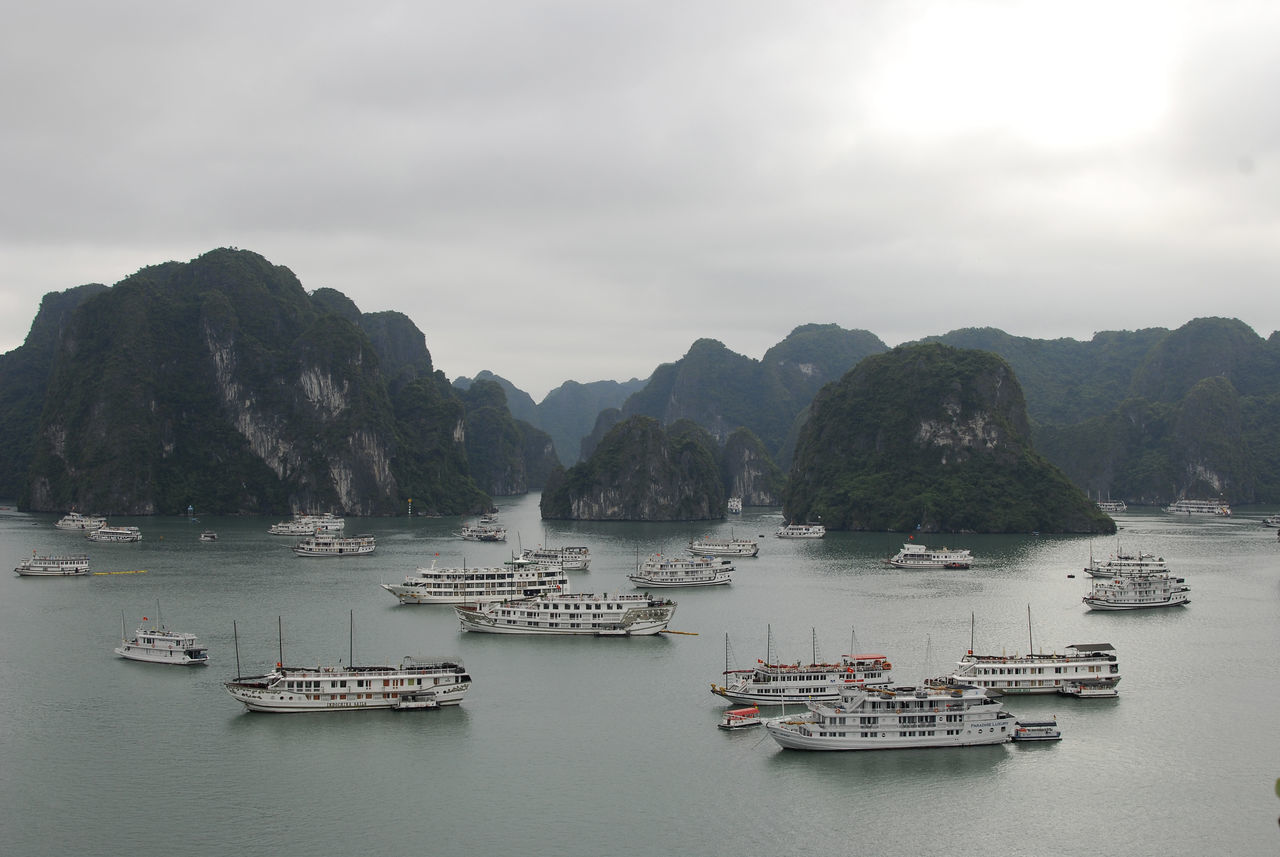 Beauty In Nature Boat Calm Cloud - Sky Day Halong Halong Bay Vietnam Mountain Nature Nautical Vessel Ocean Passenger Craft Sailing Scenics Sea Sky Tranquil Scene Tranquility Vietnam Water Waterfront