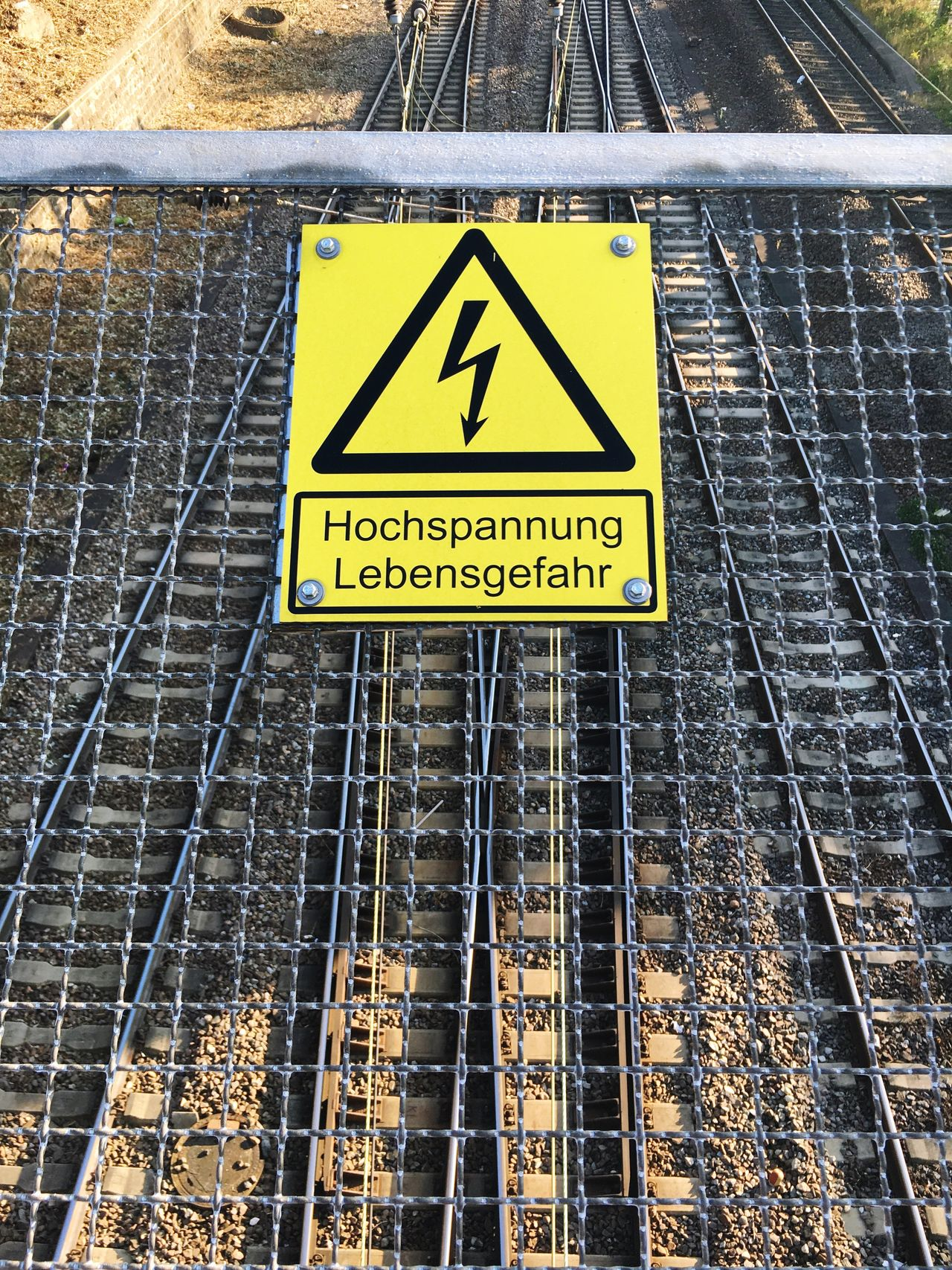 Urban Geometry Communication Western Script Text Yellow Warning Sign Sign Information Sign Close-up Information Day Outdoors Signboard Geometric Shape No People Railway Rail Rails Sign Signs Street Photography Streetphotography Geometric Shapes Geometry Urban