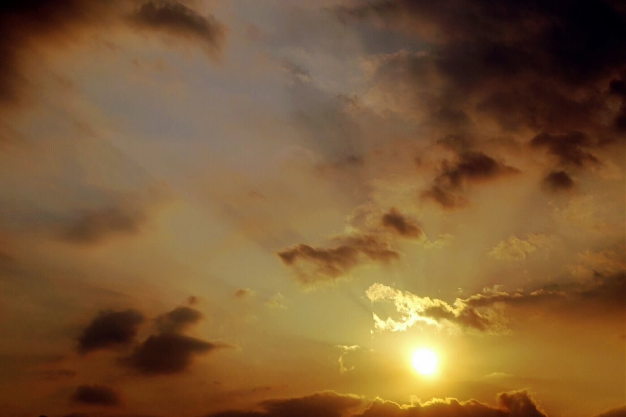 nature, sunset, beauty in nature, sky, cloud - sky, dramatic sky, scenics, tranquility, sun, tranquil scene, no people, sky only, low angle view, outdoors, yellow, backgrounds, day