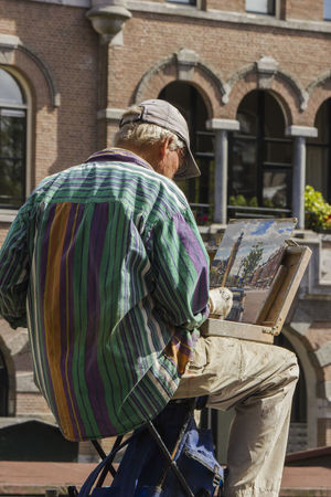 Amsterdam Netherlands Adult Architecture Day Men One Person Outdoors Painted Image Painting People People Photography Real People Street Art Street Painter Street Photography StreetActivity Streetart Streetphotography Be. Ready. Be.Ready