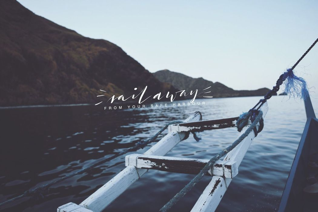 Brushlettering Calligraphy Calm Clear Sky Day Empty Group Of Objects Mountain Mountain Range Nature Nautical Vessel No People Ocean Outdoors Scenics Sea Ship Sky Solitude Tranquil Scene Tranquility Typography Water