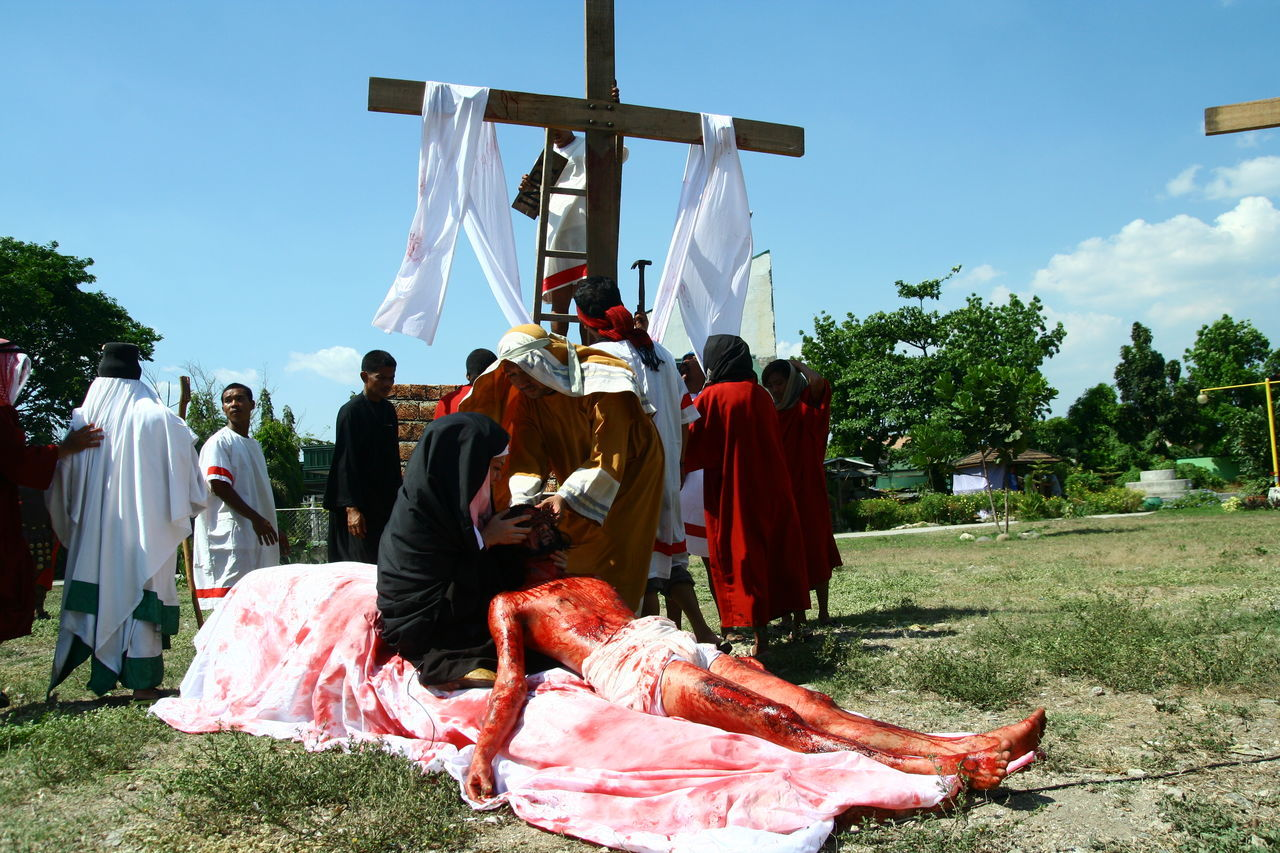 Catholic devotees reenact the Passion of Christ on Good Friday during Holy Week celebration. During the reenactment, devotees carry a large heavy wooden cross and are whipped while doing so. And some are nailed to the cross. Devotees believe that by reenacting the suffering of Christ, they are cleansed of their sins. ASIA Asian  Catholic Christian Cross Crown Of Thorns Crucifixion Crucifixion Of Christ Culture Filipino Good Friday Holy Week Holy Week Celebrations Jesus Christ Passion Of Christ People Philippines Pieta Religion Scourging Semana Santa Senakulo The Photojournalist - 2017 EyeEm Awards Tradition Virgin Mary