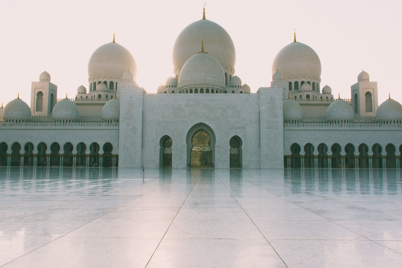 Sheikh Zayed Mosque at Sunset - Abu Dhabi Arch Architecture Building Exterior Built Structure Cultures Dome Façade Fashion History Marble Monument Nature No People Outdoors Place Of Worship Sky Sunset Tomb Tourism Travel Travel Destinations Water