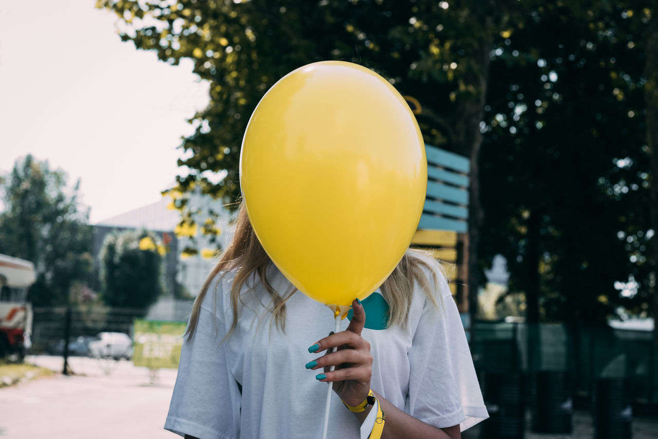 one young woman only front view one person people balloon holding young women human body part Standing The Week on EyeEm 100 Shades of Yellow Paint the Town Yellow one woman only Fresh on Market 2017