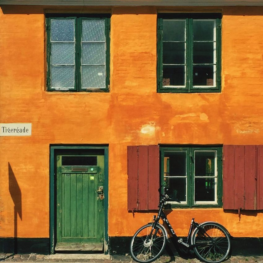 Nyboder, Copenhagen • • • • Window Architecture Building Exterior Built Structure Bicycle Transportation Parking Mode Of Transport Closed Vibrant Color Stationary City Outdoors Orange Color Day Entrance City Life Green Color Outside Parked Copenhagen København Nyboder Bike Windows First Eyeem Photo