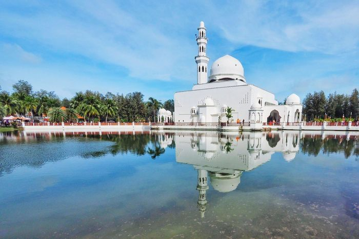 A Beautiful View Of Masjid Tengku Tengah Zaharah Or Locally Known As Floating Mosque. Mosque Building Exterior Islamic Architecture Islamic Lake Sky Clould Architecture Terengganu ASIA Malaysia Reflection Sunlight Floating On Water Floating Mosque Nice Day Water Reflection Sky Architecture Water Religion Lake Cloud - Sky Travel Destinations Outdoors Dome Building Exterior No People
