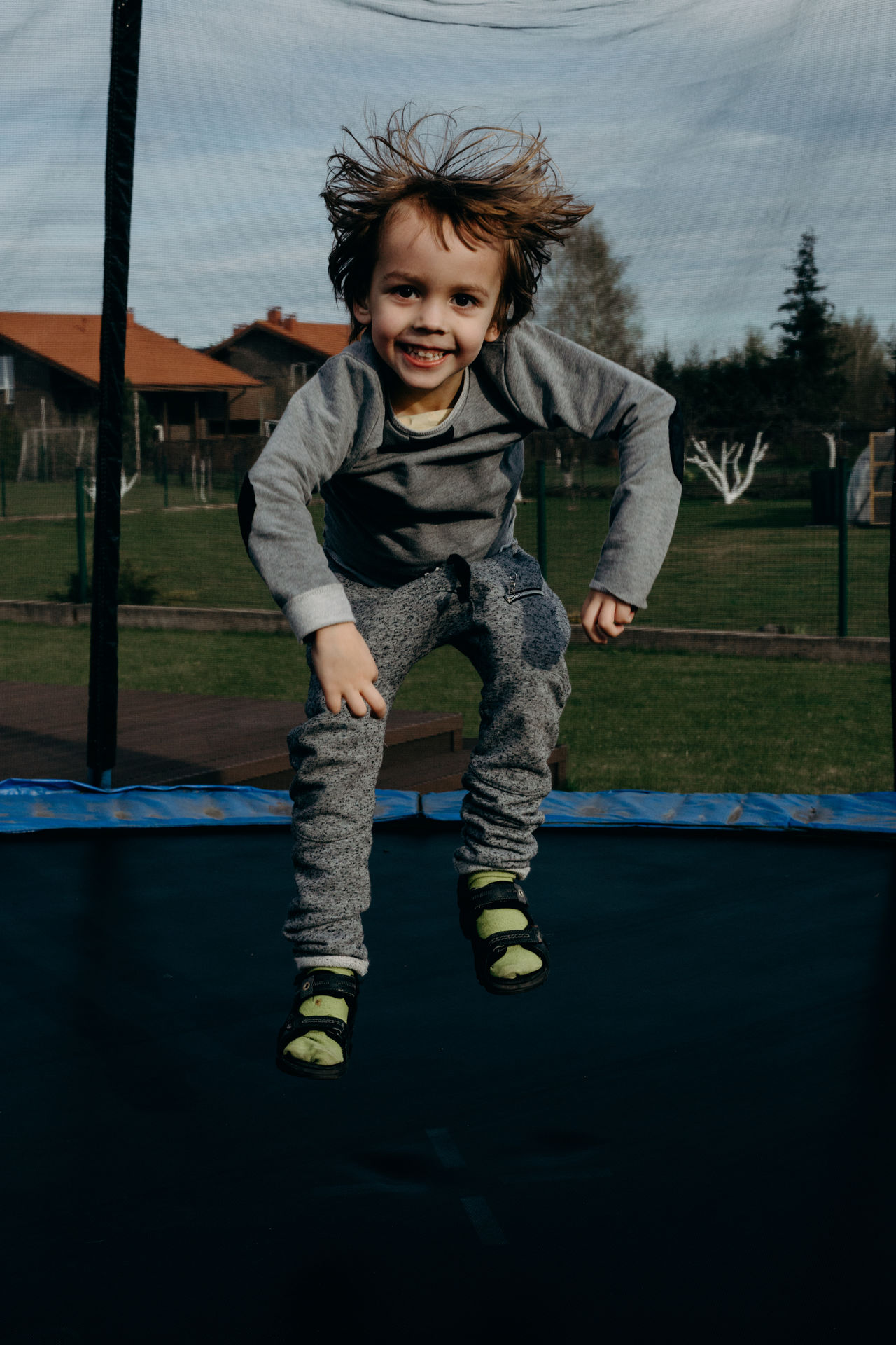 Boys Cheerful Childhood Day Elementary Age Enjoyment Front View Full Length Fun Happiness Jumping Leisure Activity Looking At Camera Motion One Person Outdoors People Playing Portrait Real People Sky Smiling Tree