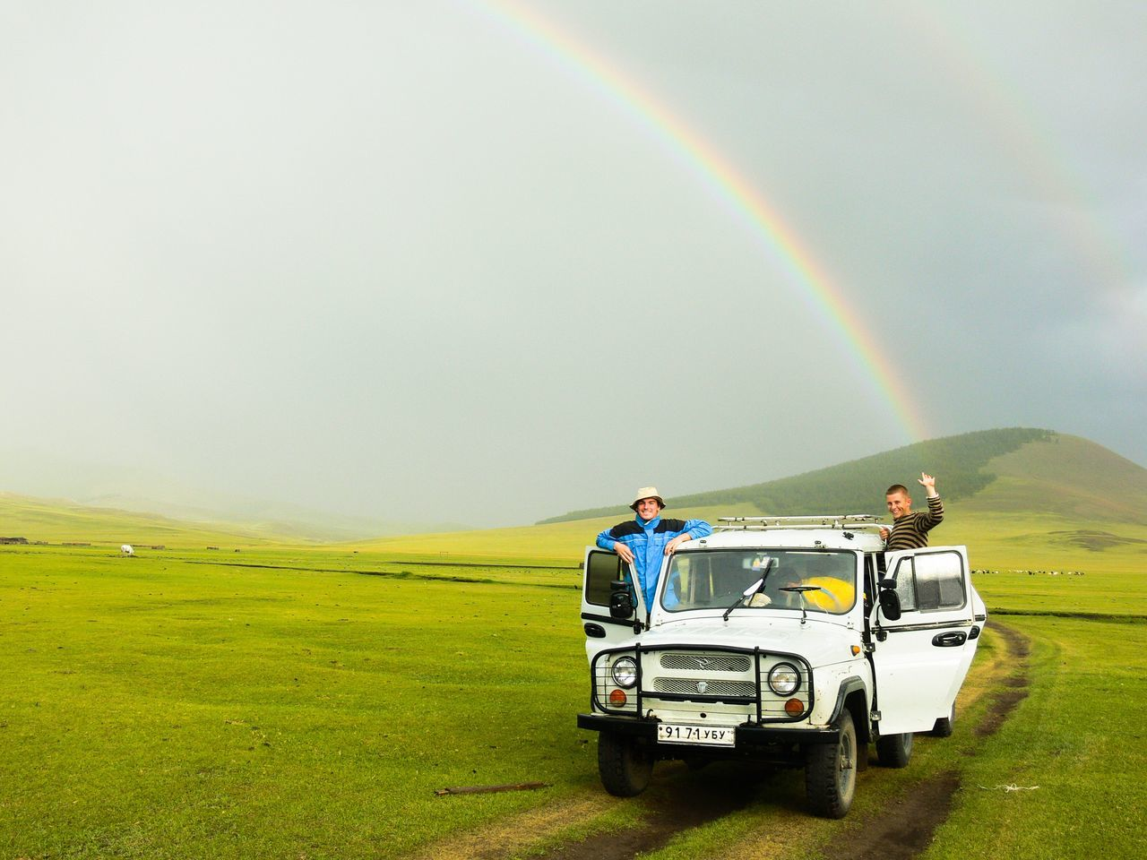 Two People Beauty In Nature Nature Scenics People Young Adult Adults Only Outdoors Community Outreach Full Length Rainbow Pointing Adventure Mongolia Fresh Grassland Car Trip Tourism Travel Landscape Remote Tranquility Happy Transportation