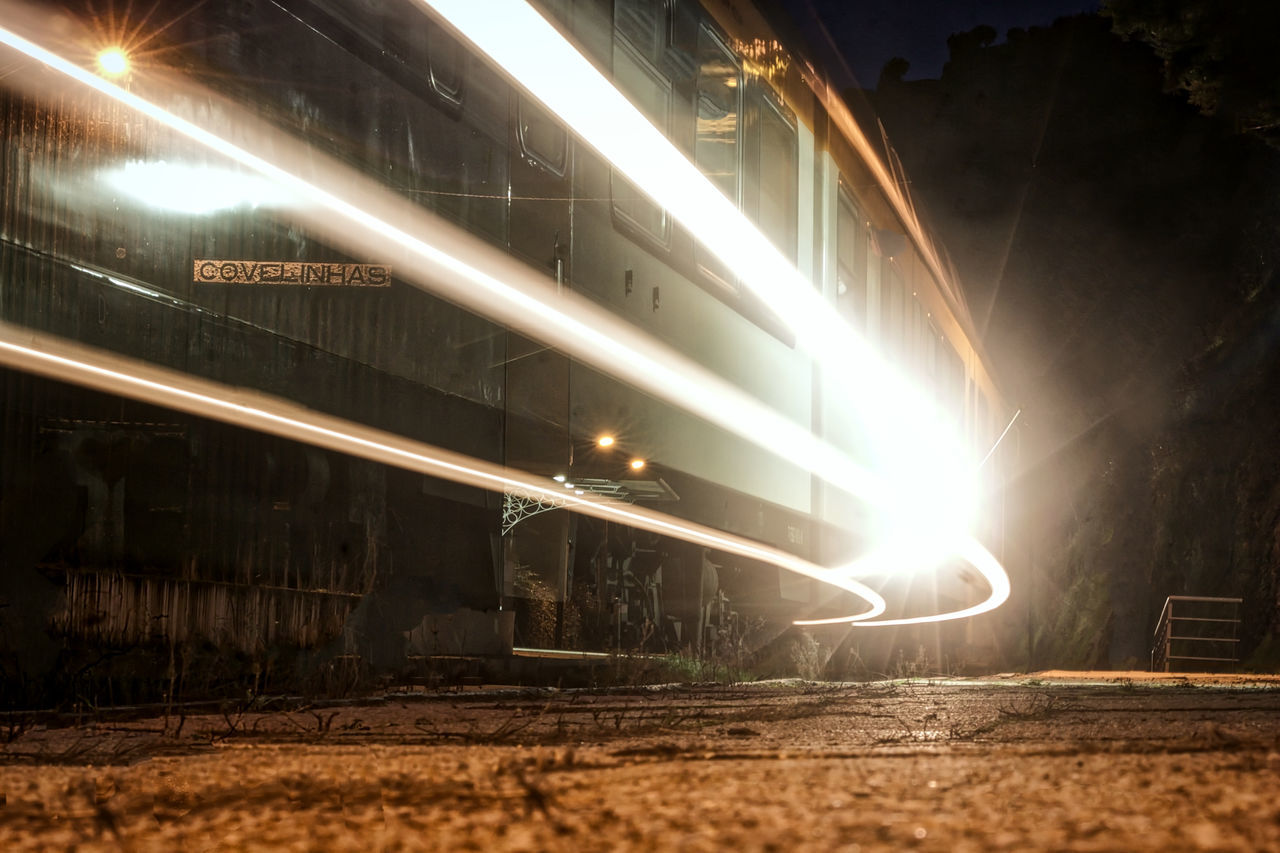 Douro  Illuminated Lens Flare Low Angle View Mode Of Transport Night No People Outdoors Rail Transportation Railroad Track Train Transportation