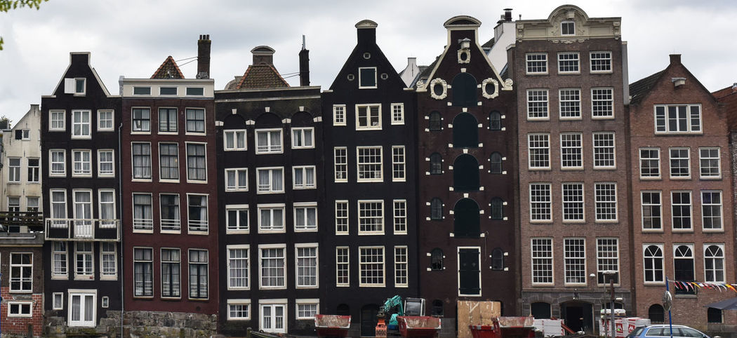 Amsterdam Houses Apartment Architecture Building Exterior Built Structure City Day Dutch Funny Funny Houses No People Outdoors Residential Building Sky Story Storytelling Window EyEmNewHere Your Ticket To Europe