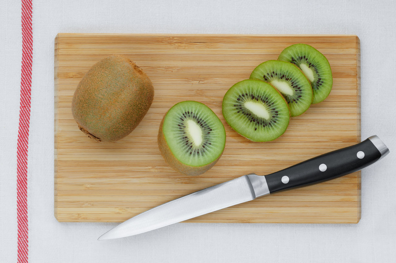 Close-up Cutting Board Day Directly Above Food Food And Drink Freshness Fruit Healthy Eating High Angle View Indoors  Kitchen Knife Kiwi - Fruit No People Ready-to-eat SLICE Still Life Studio Shot