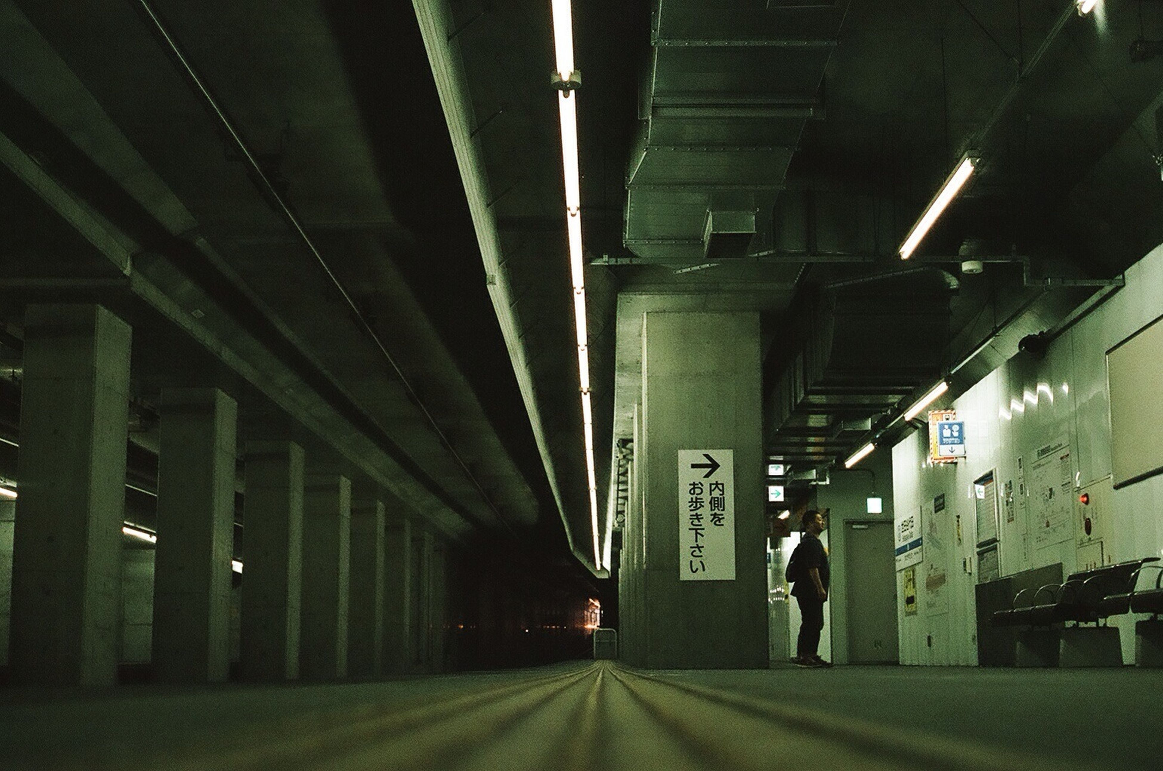 transportation, illuminated, indoors, rail transportation, public transportation, railroad track, railroad station platform, railroad station, night, the way forward, ceiling, train - vehicle, built structure, diminishing perspective, subway, tunnel, architecture, lighting equipment, mode of transport, subway station