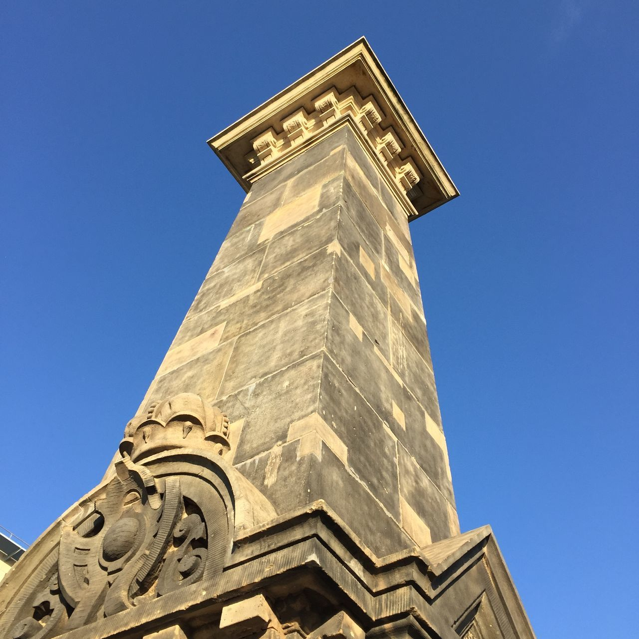 Low Angle View Of Historic Column Against Clear Blue Sky