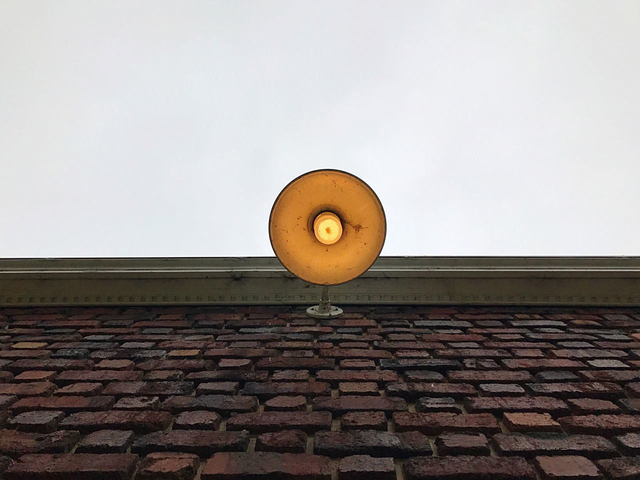 Roof No People Architecture Built Structure Low Angle View Outdoors Day Building Exterior Sky Light Fixture Brick Wall