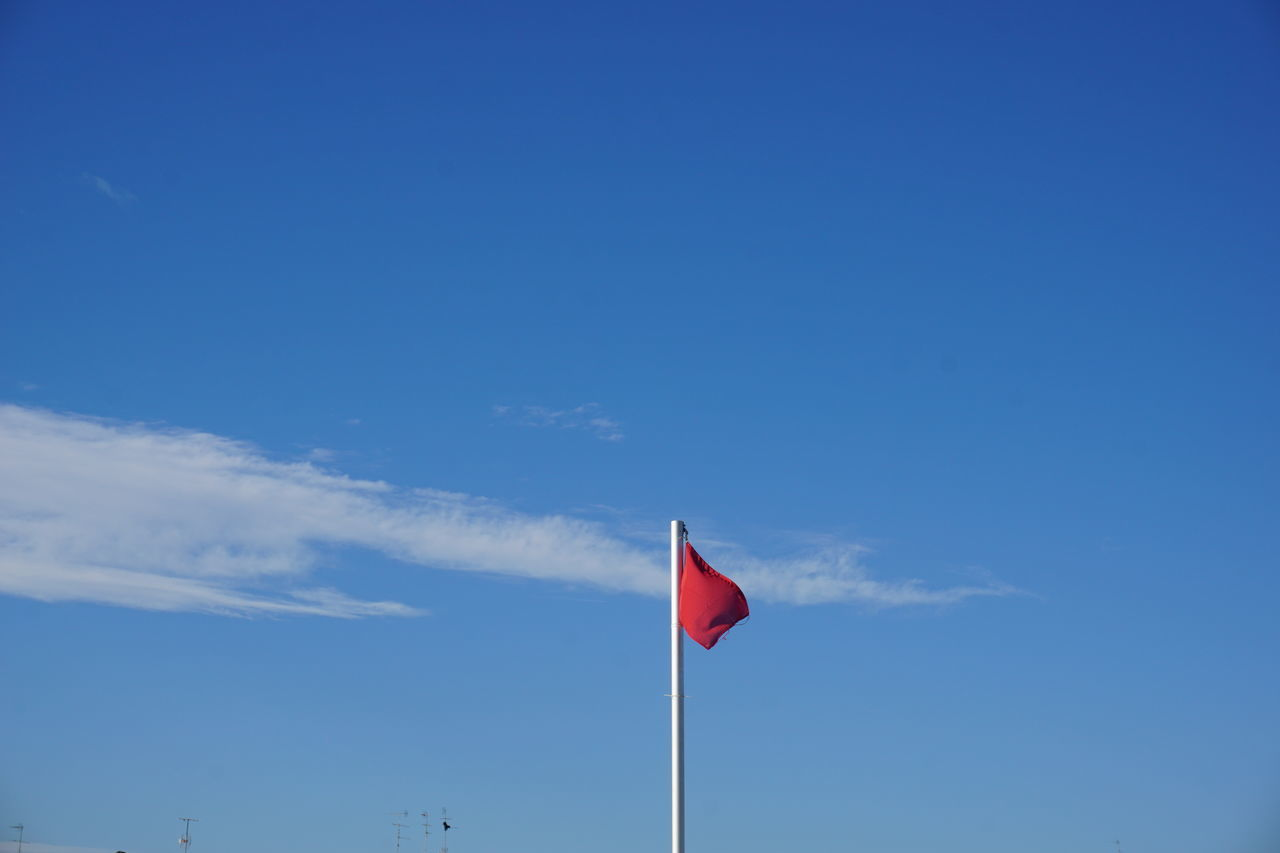 Nofilter Noedit Flag Sky Blue Red Color Red Flag Cloud - Sky Quiet Place  Looking Up Outdoor Photography Sky Space Nature Colors Winter Low Angle View No People Outdoors Nature Day Adriatic Coast Nature Photography Alone Flag Sonya6000