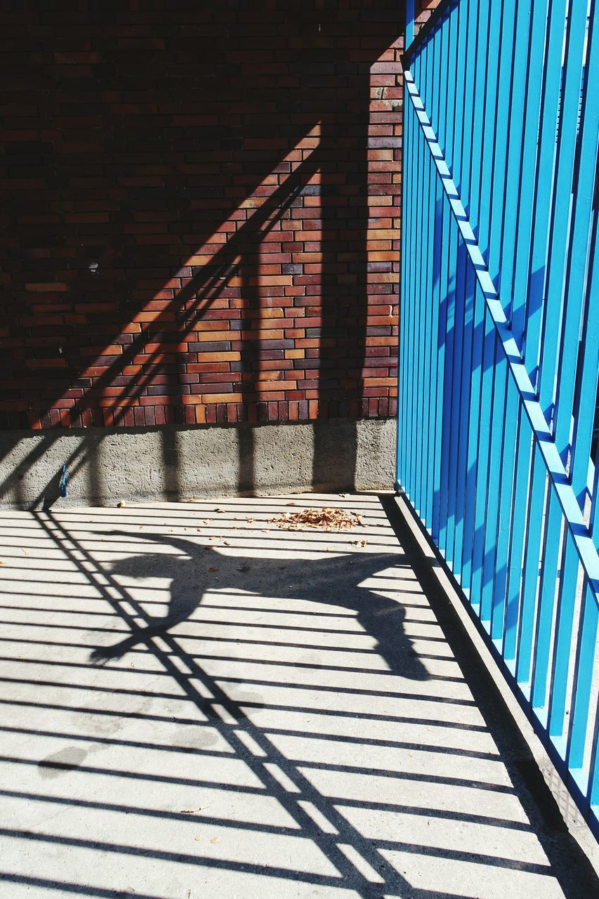 Shadow Of Person On Footpath During Sunny Day