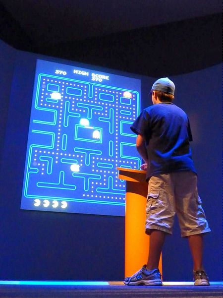 Boy Taking Care Of Business with Museum Pacman in Washington DC Living The Dream
