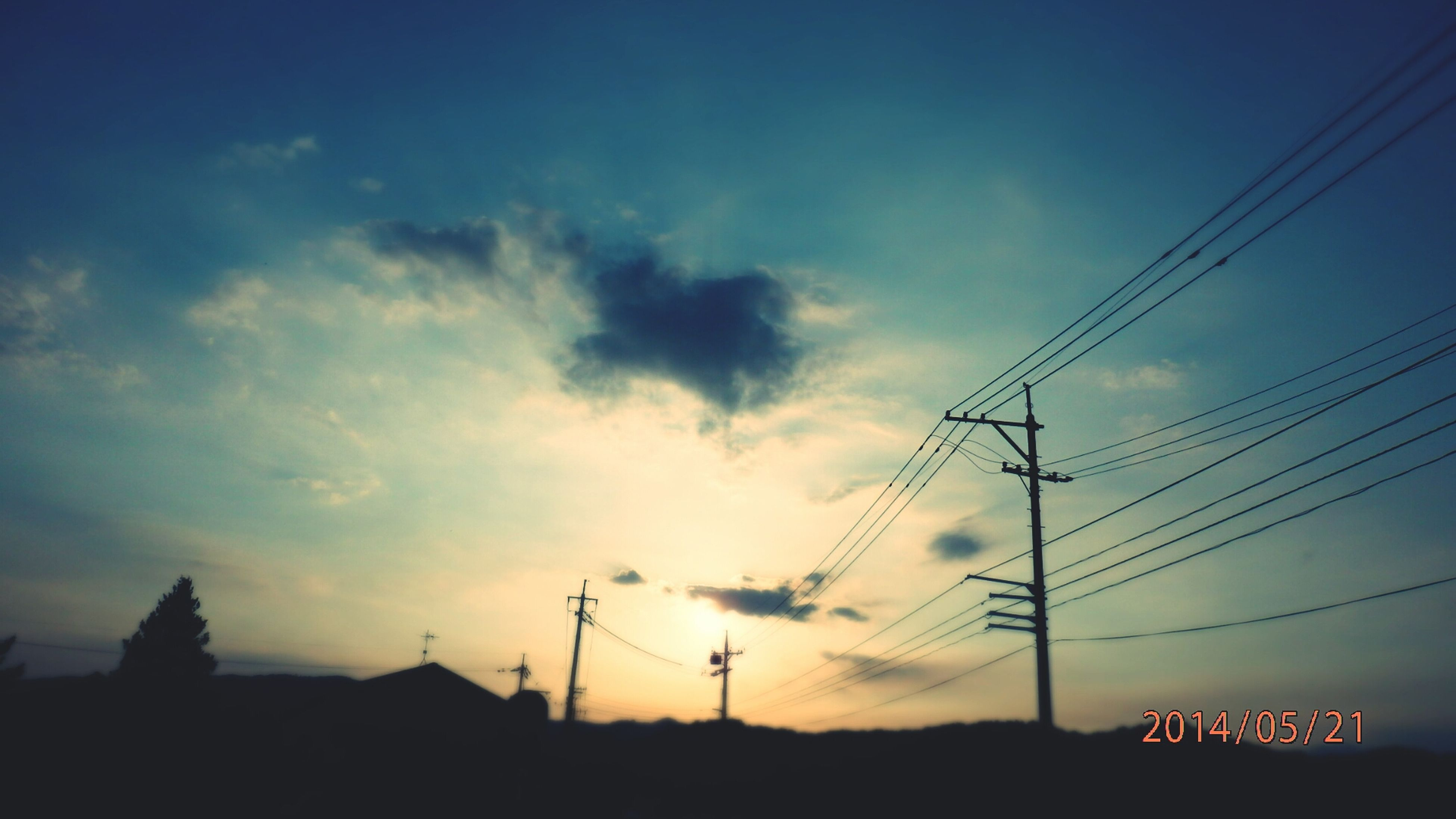 power line, electricity pylon, power supply, electricity, sky, cable, connection, low angle view, silhouette, fuel and power generation, technology, sunset, cloud - sky, power cable, built structure, dusk, cloud, building exterior, communication, outdoors