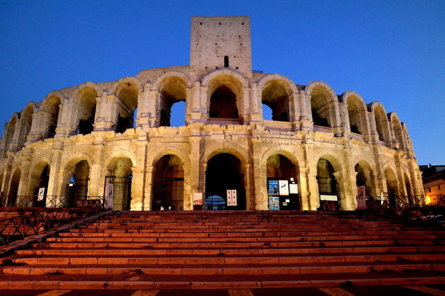 Ancient Architecture Ancient Civilization Architecture Arena Arles Blue Sky Building Exterior Built Structure Camargue Clear Sky Coliseum Eye4photography  EyeEm Best Shots EyeEm Gallery EyeEmBestPics Façade Famous Place France Historical Building History Illuminated In Front Of Low Angle View Stairway Travel Destinations