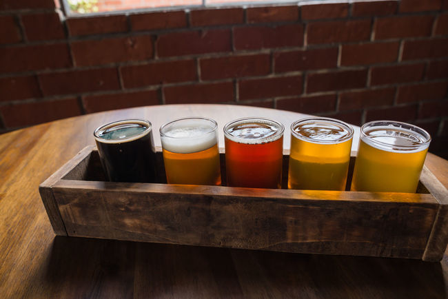 Happy hour Alcohol Arrangement Beer Beer Sampler Beers Beersnob Brewery Close-up Day Drinks Focus On Foreground Happy Hour Jar No People Refreshment Side By Side Still Life Wood - Material Yellow