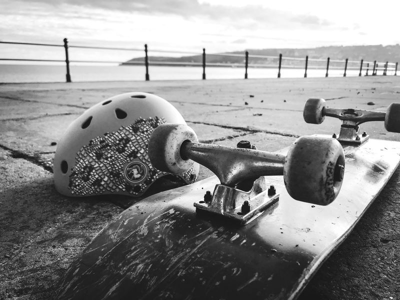 Having a rest Water Metal Beach Sea Outdoors Close-up Objects Safety Helmet Wheels Skateboard Getting Down To The Ground Blackandwhite Railings Black And White Friday One Step Forward