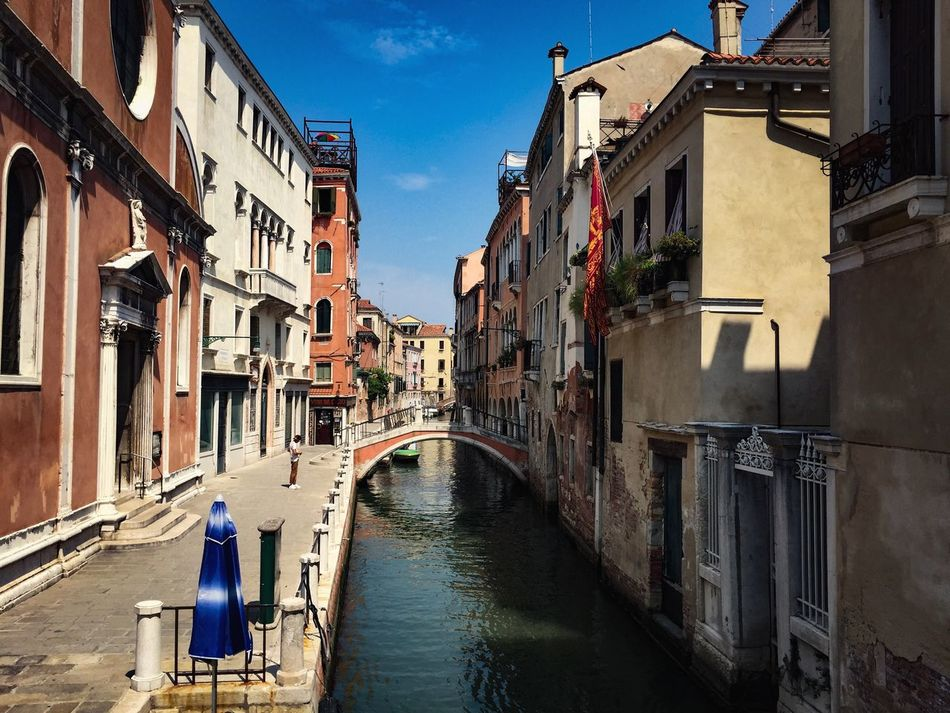 Architecture Building Exterior Built Structure Sky Canal Rear View Residential Building Day Real People Outdoors Water Town Full Length Women City One Person People