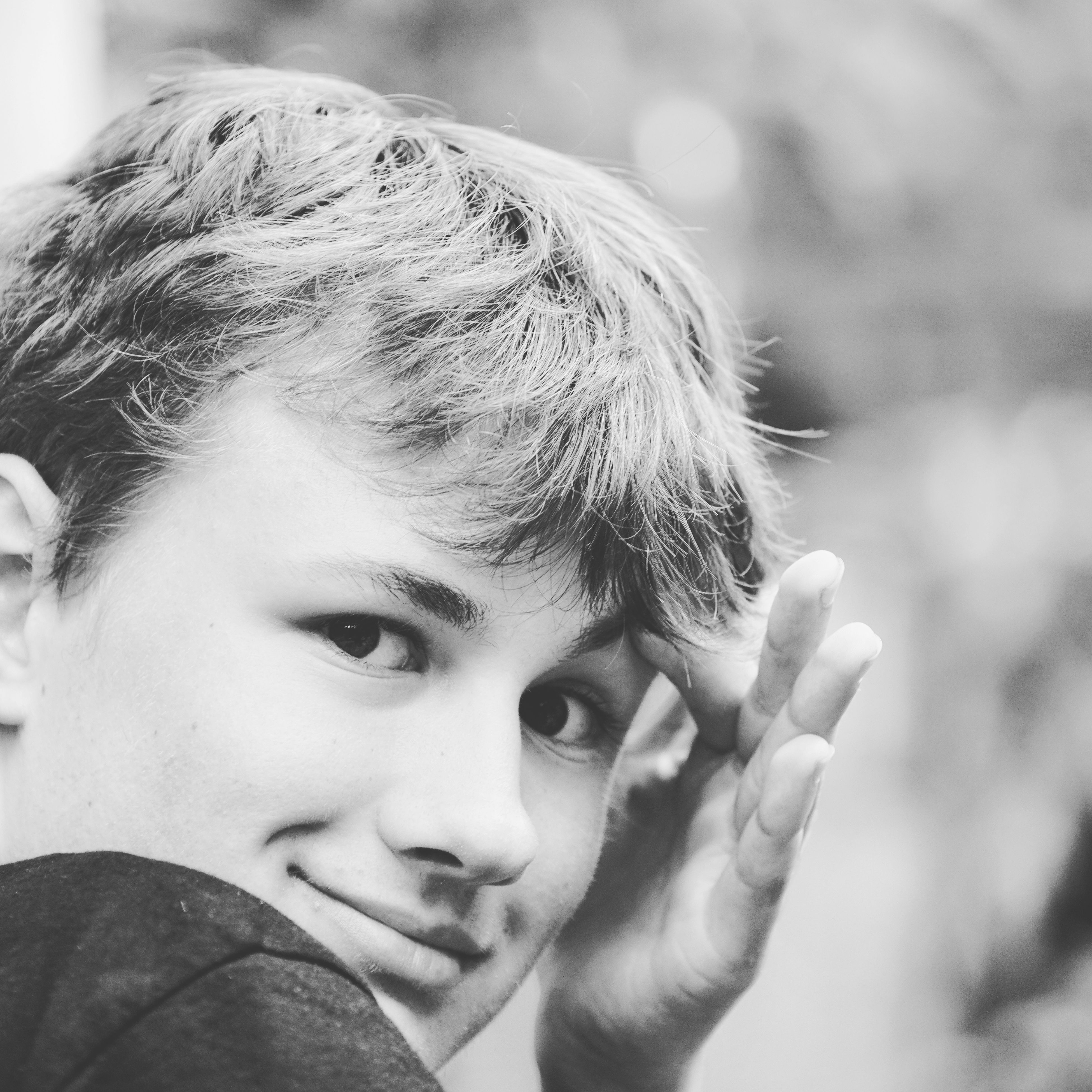 one person, childhood, real people, focus on foreground, headshot, close-up, boys, elementary age, portrait, lifestyles, day, looking at camera, outdoors, people