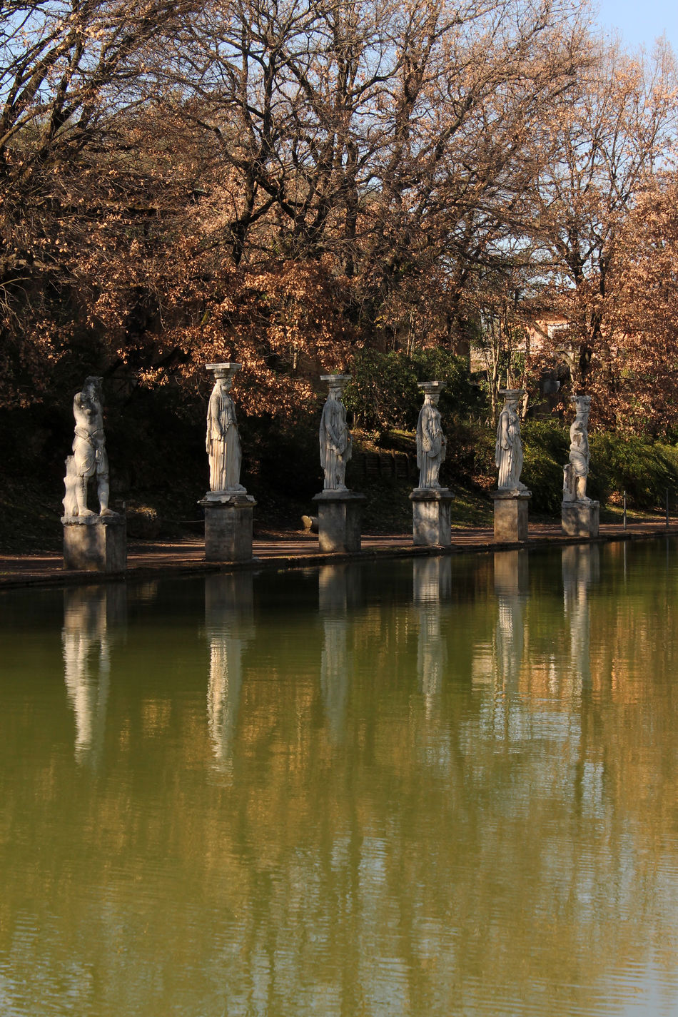 Archeological Site Archeology Art Art Lover Art Photography Beauty In Nature Canopo Cariatidi Day History Mirrored Nature No People Outdoors Reflection Reflection Reflections In The Water Roman Empire Roman Sculpture Sculpture Statue Tree Villa Adriana