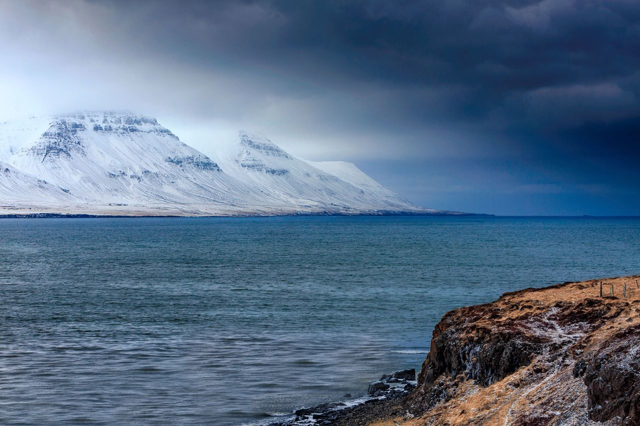 Beauty In Nature Cold Temperature Snow Mountain Scenics Nature Tranquil Scene Winter Tranquility Landscape Outdoors Sky Sea Snowcapped Mountain Water No People Mountain Range Day Iceberg Iceland Atlantic Ocean North Northern Iceland Storm Cloud Stormy Weather