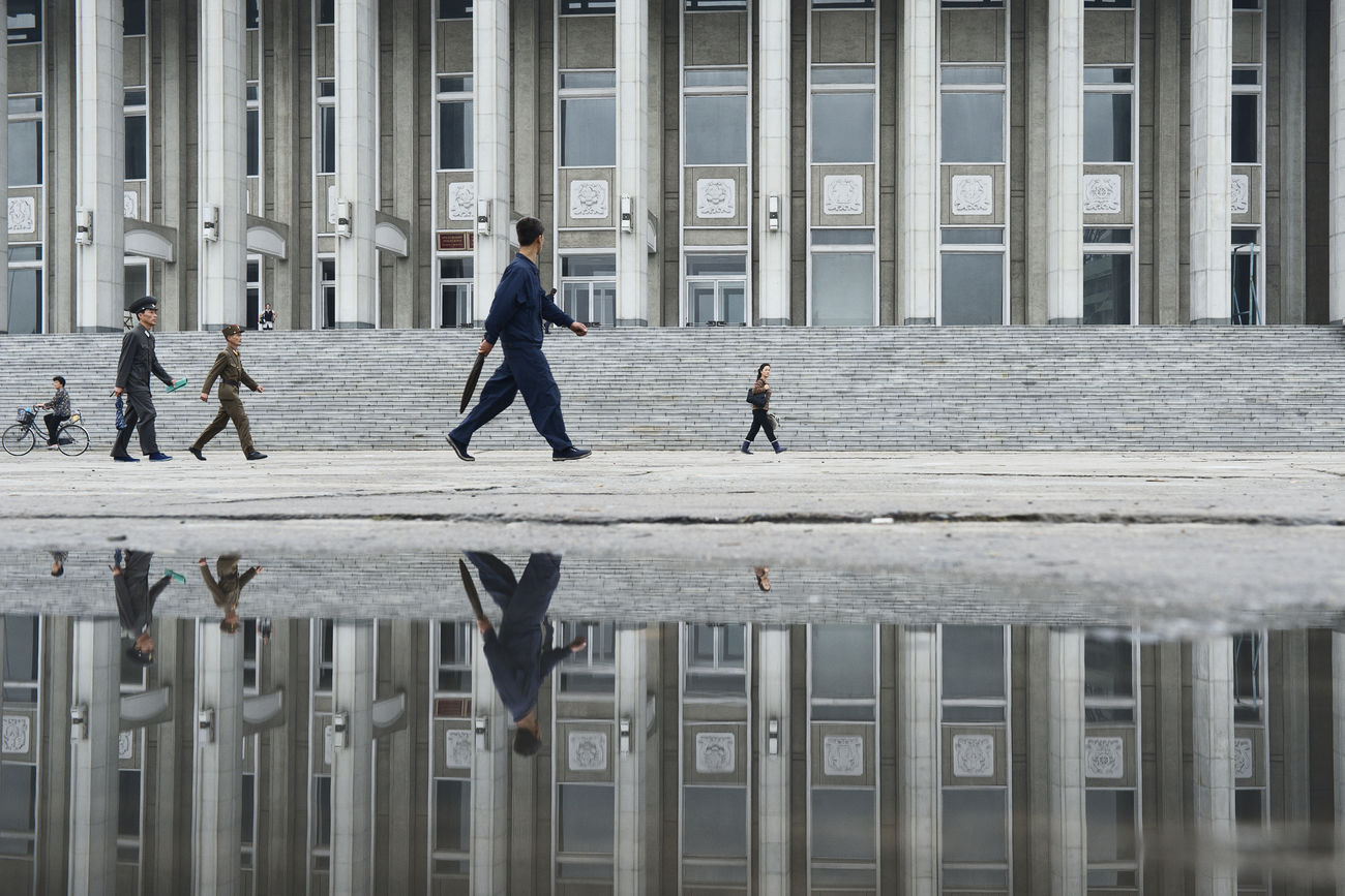 Reflection of people walking outside Hamhung Grand Theatre. Hamhŭng is an important chemical industry center in the DPRK. It is an industrial city which serves as a major port for North Korean foreign trade. Production includes textiles, metalware, machinery, refined oil and processed food. Hello World Reflection North Korea DPRK Architecture Eye4photography  Streetphotography Traveling Capture The Moment EyeEm Best Shots