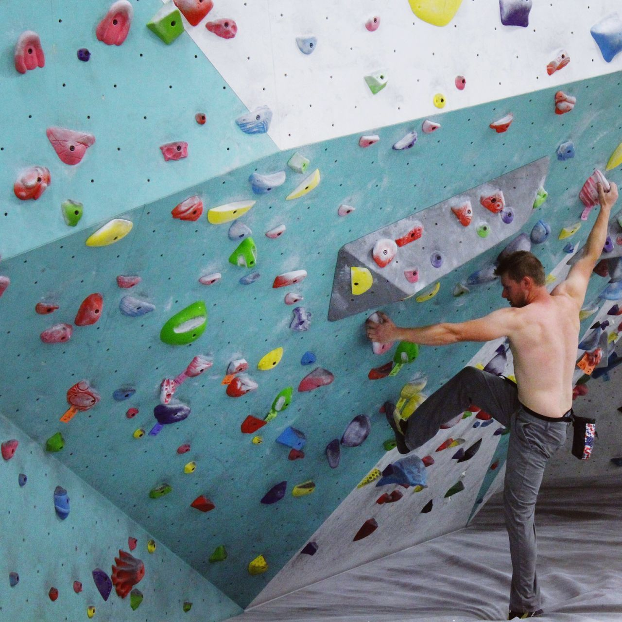 Healthy Lifestyle Climbing Climbing Wall Challenge Exercising Balance Strength Effort Determination Practicing Sport Indoors  Flexibility Endurance One Person Health Club People Skill  Athlete Stretching Self Improvement Wellbeing Indoors  Gripping Rock Climbing
