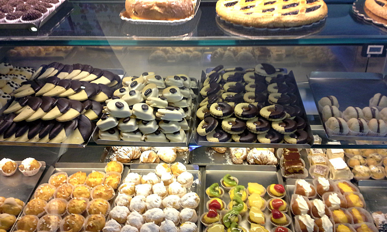 Cookies, pies, and pastries on delicious display. Abundance Bakery Biscotti Cake Chocolate Choice Cookies Dessert Food Food And Drink Freshness Indoors  Indulgence No People Pastry Ready-to-eat Shelf Sweet Food Temptation Unhealthy Eating Variation
