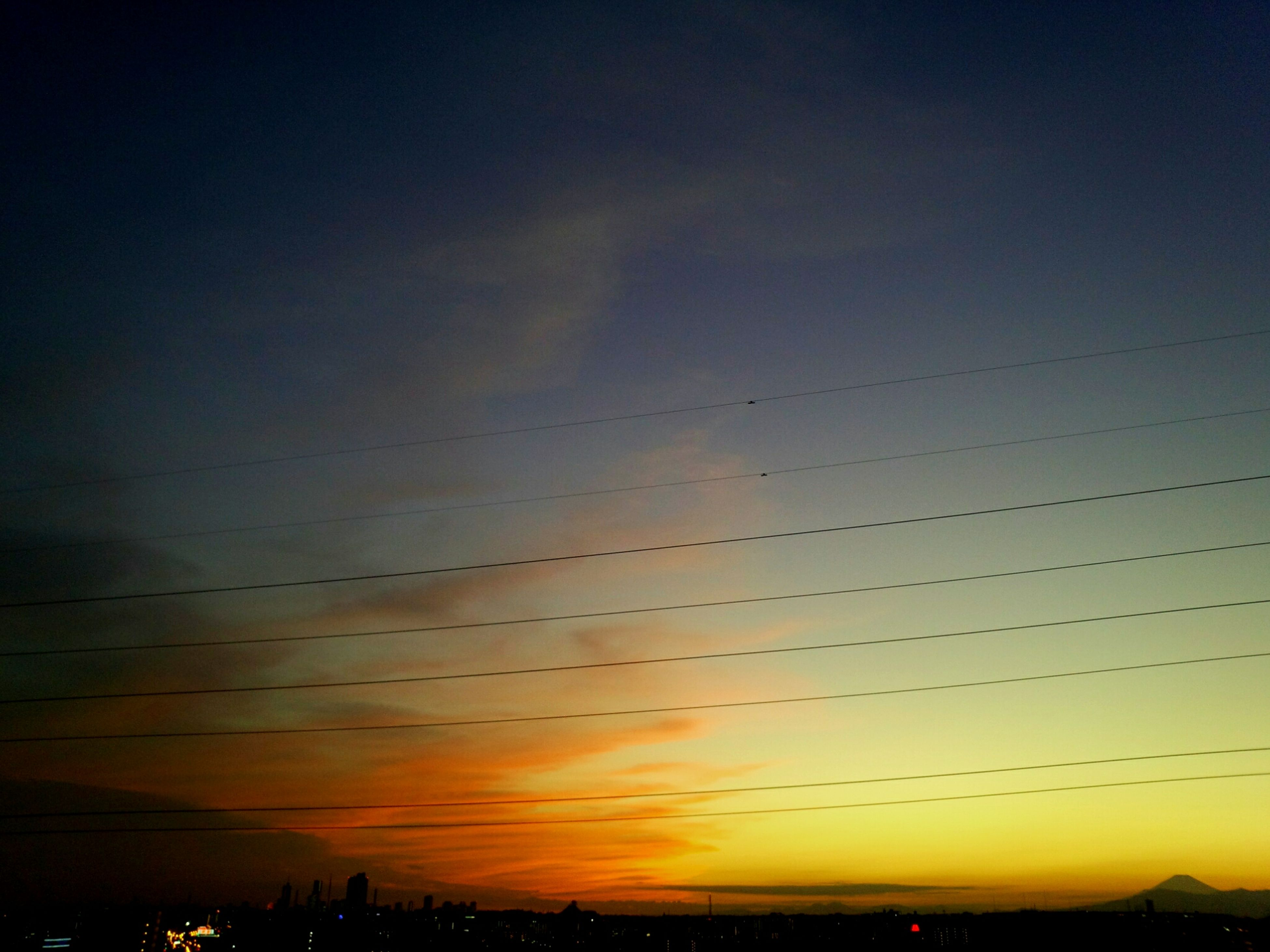 sunset, silhouette, scenics, sky, tranquil scene, tranquility, beauty in nature, nature, dusk, orange color, idyllic, copy space, power line, landscape, outdoors, outline, bird, low angle view, no people, cloud - sky