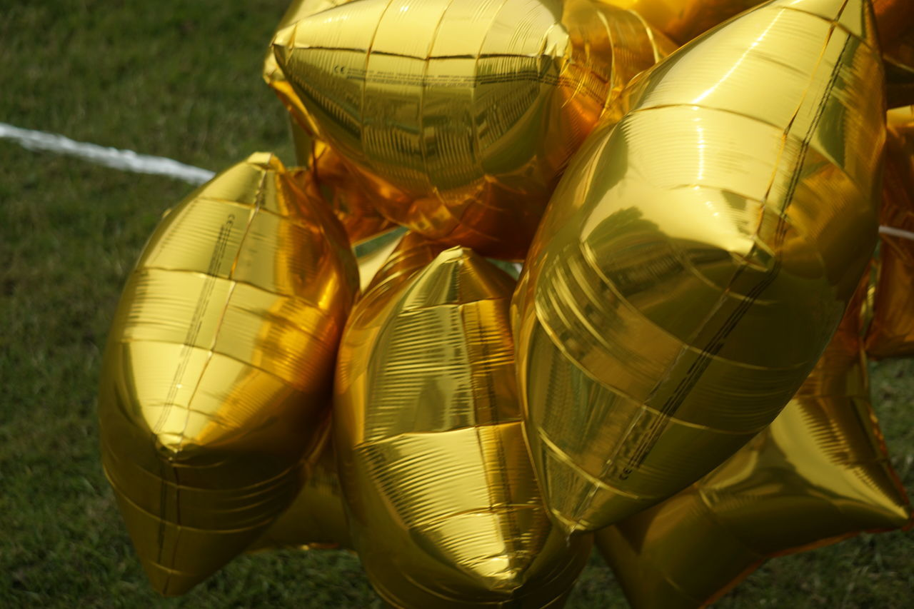 Backgrounds Balloons Close-up Day Gold Colored Golden Mylar Balloons No People Stars Wallpaper