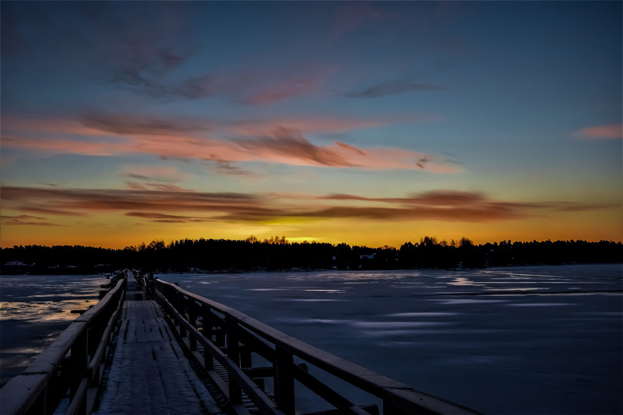 Beauty In Nature Bridge Cloud - Sky Cold Temperature Devil's Bridge Dramatic Sky Frosty Ice Lake Landscape Nature Night No People Outdoors Scenics Sunset Travel Destinations Tree Water