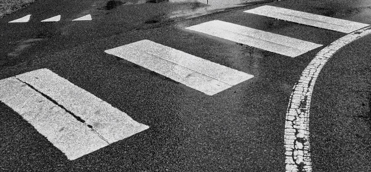 Road Marking Striped Transportation Guidance High Angle View No People Road Sign Outdoors Road Day Arrow Sign Lines And Shapes Lines, Shapes And Curves Rainy Days Direction Crossroads Blackandwhite