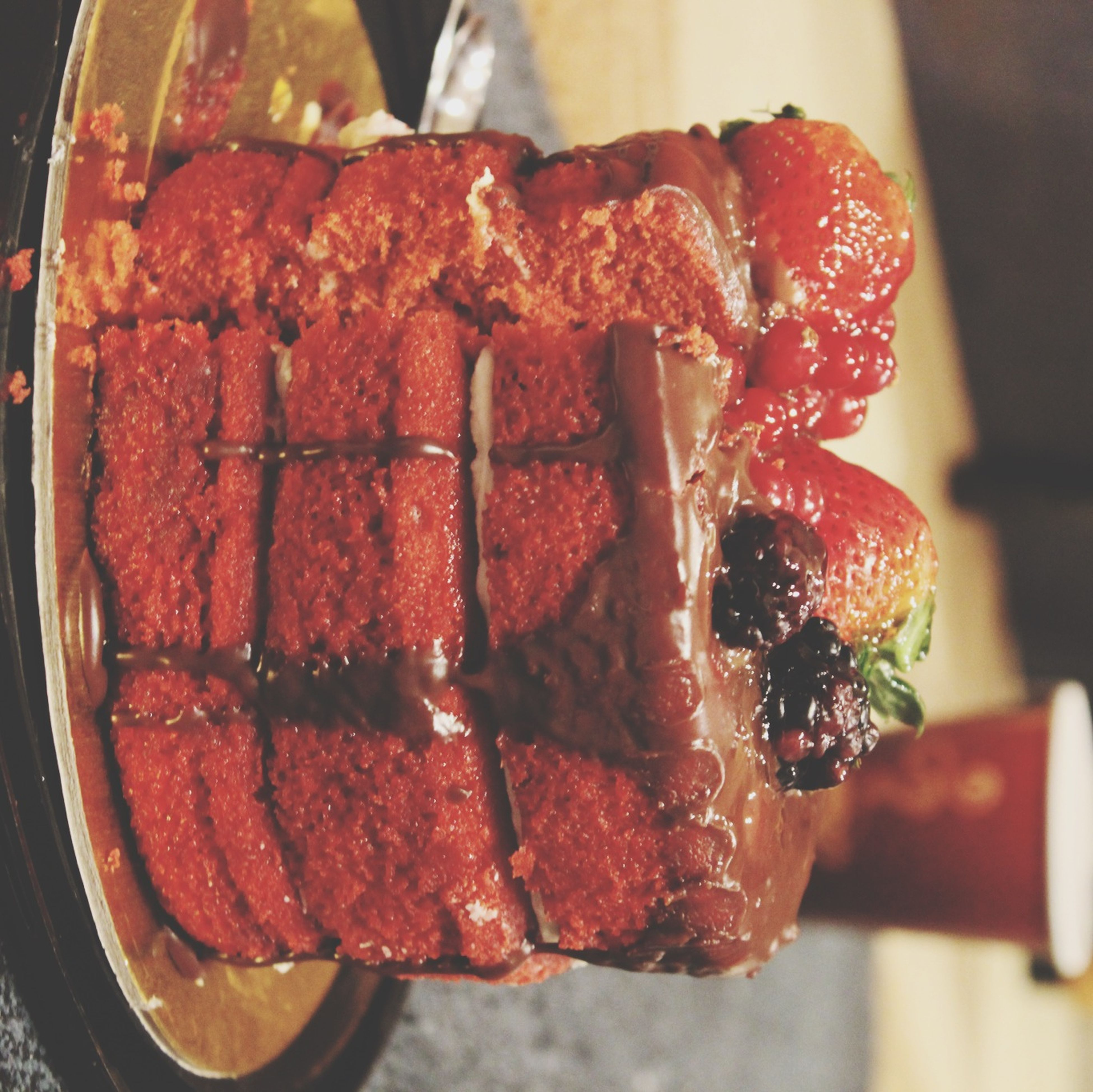 food and drink, food, indoors, freshness, ready-to-eat, unhealthy eating, indulgence, close-up, sweet food, still life, dessert, plate, focus on foreground, temptation, table, slice, cake, red, one person