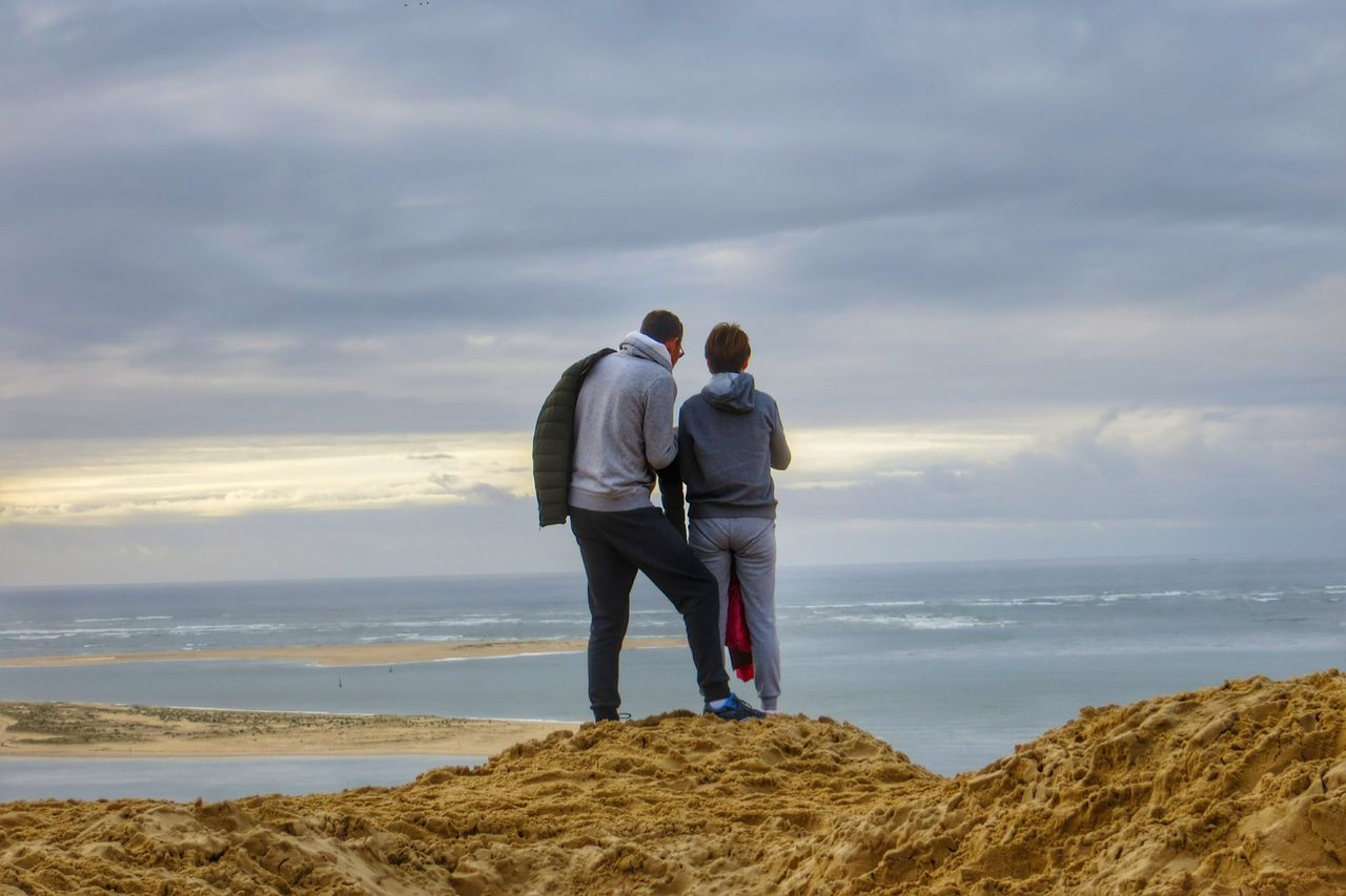 Sea Two People Beach Togetherness Full Length Adults Only Friendship Adult Rear View Outdoors Sand People Nature Vacations Retirement Cloud - Sky Tranquility Vacations Hiking EyeEm Gallery EyeEm Best Shots Travel Destinations Dune Du Pyla Water Lakeside