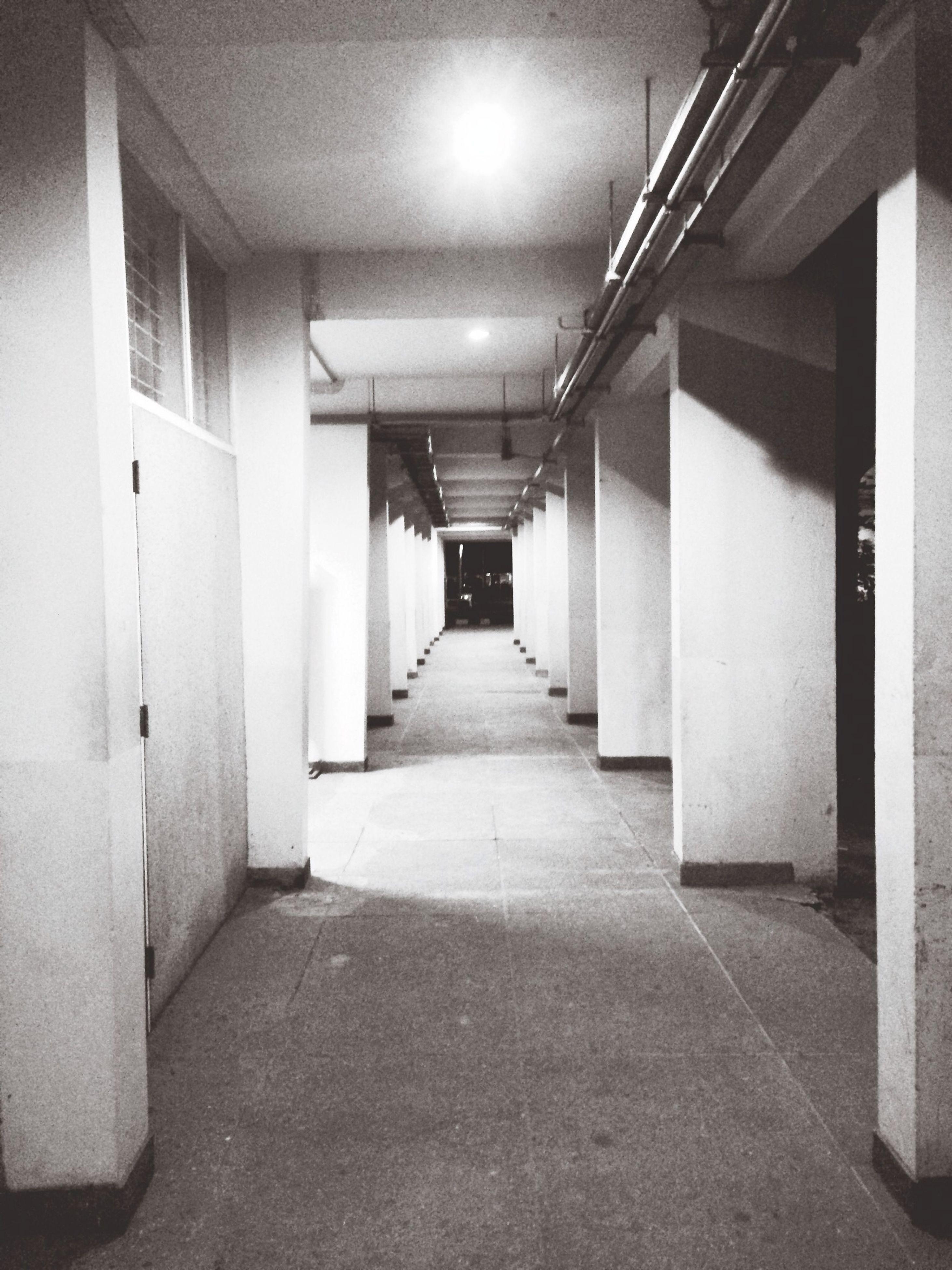 architecture, the way forward, built structure, corridor, indoors, diminishing perspective, vanishing point, narrow, empty, in a row, architectural column, illuminated, building, long, lighting equipment, building exterior, walkway, column, no people, ceiling