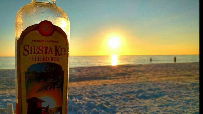 My favorite rum! Siesta Key Rum on Siesta Key Beach ! Cocktails By Sunset Cocktails On The Beach Rum & Cola Beach Drinks Sunlight Reflection Sunset_collection Sunset Silhouettes Salt Life Therepy Sun Rays Travel Photography Drink Responsibly Beach Photography This Is The Life Sarasota Florida Cheers Beach Daze Sunny Day Enjoying Life
